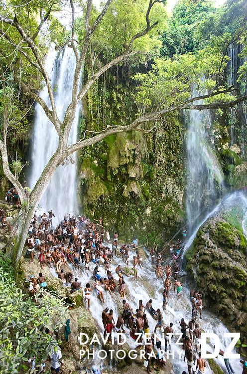 Thousands of Voodou worshippers bathe in the waters of Saut D'eau in central Haiti during the annual three day festival there, on July 15, 2008. Pilgrims come to honor the Virgin Mary or la vyej, her voodou counterpart, Ezili Freda, as well as Danbala, the great serpentine lord of the waterfall, and other lwas, or spirits.