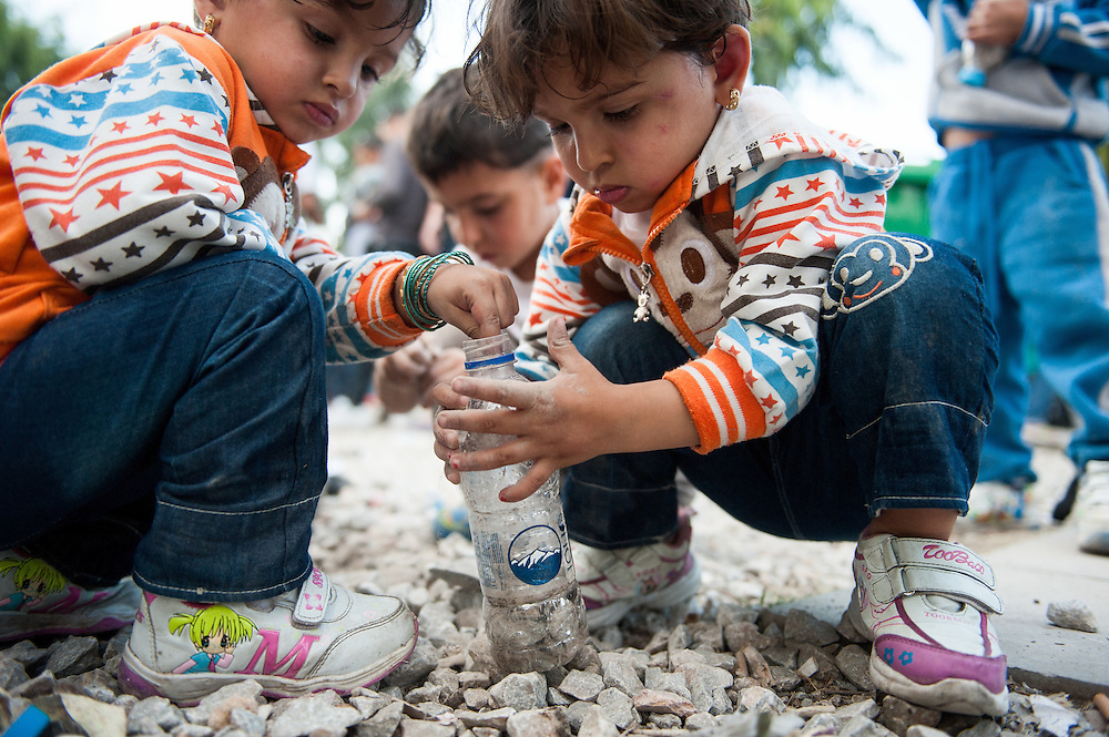 Twin sisters Narin and Darin 3 years old from Aleppo Syria playing in Kara Tepe camp, Lesvos, Greece