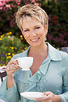 Smiling Woman With a Cup of Tea