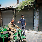 August 14, 2012 - Aleppo, Syria: A Free Syria Army fighter orders a local resident to proceed in a rebel checkpoint in Babal Nassar neighborhood in Aleppo's old city. The Syrian Army have in the past ten days increased their attacks on residential neighborhoods where Free Syria Army rebel fights have their positions in Syria's commercial capital, Aleppo. (Paulo Nunes dos Santos/Polaris)