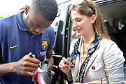 Alex Song from Barcelona signs his autographs after press conference in The Polish Baltic Fr&eacute;d&eacute;ric Chopin Philharmonic in Gdansk, Poland.<br /> A few hours before friendly match between Lechia Gdansk and FC Barcelona.<br /> <br /> Poland, Gdansk, July 30, 2013<br /> <br /> Picture also available in RAW (NEF) or TIFF format on special request.<br /> <br /> For editorial use only. Any commercial or promotional use requires permission.<br /> <br /> Photo by &copy; Adam Nurkiewicz / Mediasport