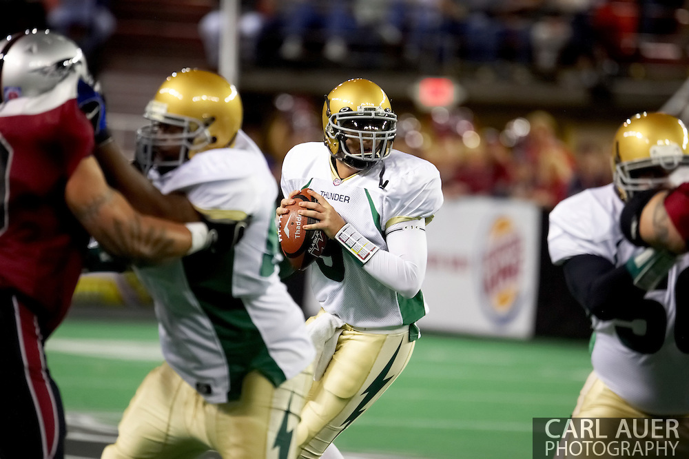 4/12/2007 - Dustin Almond (9) drops back to pass for the Frisco Thunder in the 46-33 win over the Alaska Wild in the first professional football game in Alaska.
