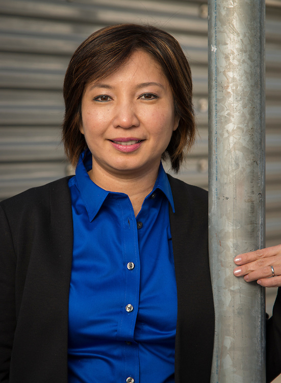 Westside High School facilities manager Helen Tran poses for a photograph, January 7, 2014.