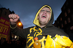 © under license to London News Pictures.  07/12/2010. A man angrily demands for the MPs inside Leinster House, Dublin, Ireland, to come outside and face the protesters on 7/12/2010. Photo credit should read Michael Graae/London News Pictures