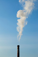 A smoke stack discharging smoke or steam in south Seattle, WA  USA