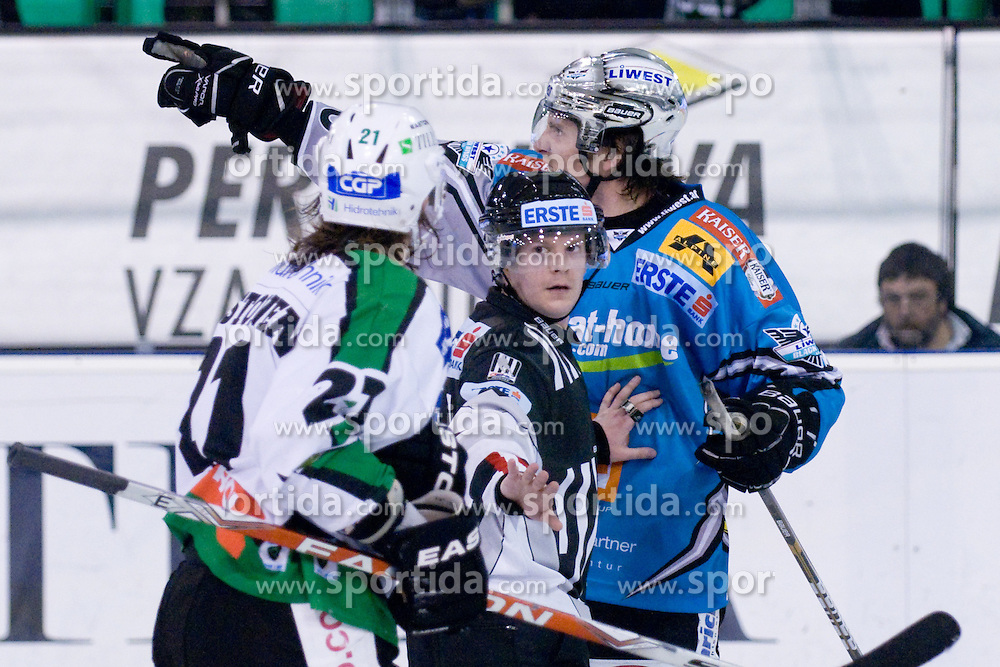 Reid Cashman (EHC Liwest Black Wings Linz, #10) and Tomi Mustonen (HDD Tilia Olimpija, #21) during ice-hockey match between HDD Tilia Olimpija and EHC Liwest Black Wings Linz in 37th Round of EBEL league, on Januar 9, 2011 at Hala Tivoli, Ljubljana, Slovenia. (Photo By Matic Klansek Velej / Sportida.com)