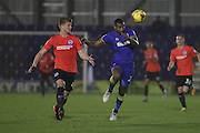 AFC Wimbledon striker Tyrone Barnett (23) and Brighton & Hove Albion defender Ben Hall (48) battle for possession during the EFL Trophy match between AFC Wimbledon and U23 Brighton and Hove Albion at the Cherry Red Records Stadium, Kingston, England on 6 December 2016. Photo by Stuart Butcher.