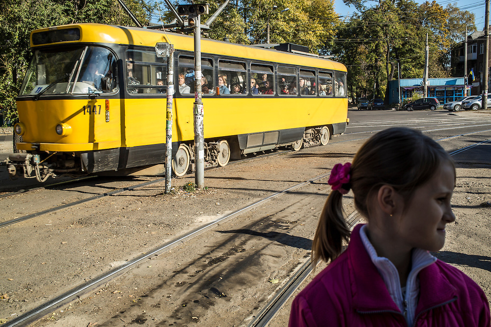 DNIPROPETROVSK, UKRAINE - OCTOBER 12: Yeva, 10, waits for a tram to begin the long trip from the Good News Evangelical Church to the home where she, her mother, and her grandmother are living with a family that is part of the congregation on October 12, 2014 in Dnipropetrovsk, Ukraine. Yeva and her family fled fighting in Luhansk. The United Nations has registered more than 360,000 people who have been forced to leave their homes due to fighting in the East, though the true number is believed to be much higher.(Photo by Brendan Hoffman/Getty Images) *** Local Caption ***