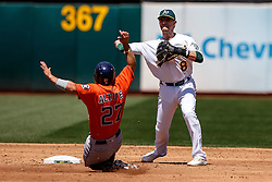 OAKLAND, CA - MAY 01:  Jose Altuve #27 of the Houston Astros breaks up a double play attempt by Jed Lowrie #8 of the Oakland Athletics during the third inning at the Oakland Coliseum on May 1, 2016 in Oakland, California. The Houston Astros defeated the Oakland Athletics 2-1. (Photo by Jason O. Watson/Getty Images) *** Local Caption *** Jose Altuve; Jed Lowrie