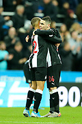 Miguel Almiron (#24) of Newcastle United celebrates with Dwight Gayle (#12) of Newcastle United following the Premier League match between Newcastle United and Crystal Palace at St. James's Park, Newcastle, England on 21 December 2019.