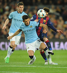 Barcelona's Lionel Messi is tackled by  Manchester City's Martin Demichelis - Photo mandatory by-line: Dougie Allward/JMP - Mobile: 07966 386802 - 18/03/2015 - SPORT - Football - Barcelona - Nou Camp - Barcelona v Manchester City - UEFA Champions League - Round 16 - Second Leg
