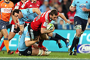 Tom Taylor tackled. NSW Waratahs v Canterbury Crusaders. Sport Rugby Union Super Rugby Representative Provincial. ANZ Stadium. 23 May 2015. Photo by Paul Seiser/SPA Images