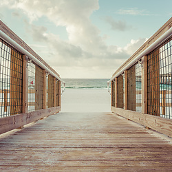 Pensacola Beach Florida beach access entrance wooden boardwalk walkway photo at Casino Beach. Pensacola Beach is on Santa Rosa Island in the Emerald Coast region of the Southeastern United States. Photo is high resolution. Copyright ⓒ 2018 Paul Velgos with All Rights Reserved.