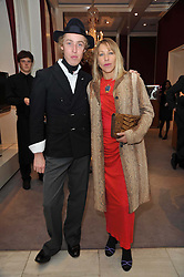 JAMES BROWN and MAIA NORMAN at a party to launch the Georgina Chapman collection for Garrard held at Garrard, Albermarle Street, London on 4th November 2009.