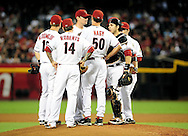 Sep. 20 2011; Phoenix, AZ, USA; Arizona Diamondbacks pitching coach Charles Nagy (50) talks with starting pitcher Daniel Hudson (41) on the field while playing against the Pittsburgh Pirates at Chase Field. Mandatory Credit: Jennifer Stewart-US PRESSWIRE.