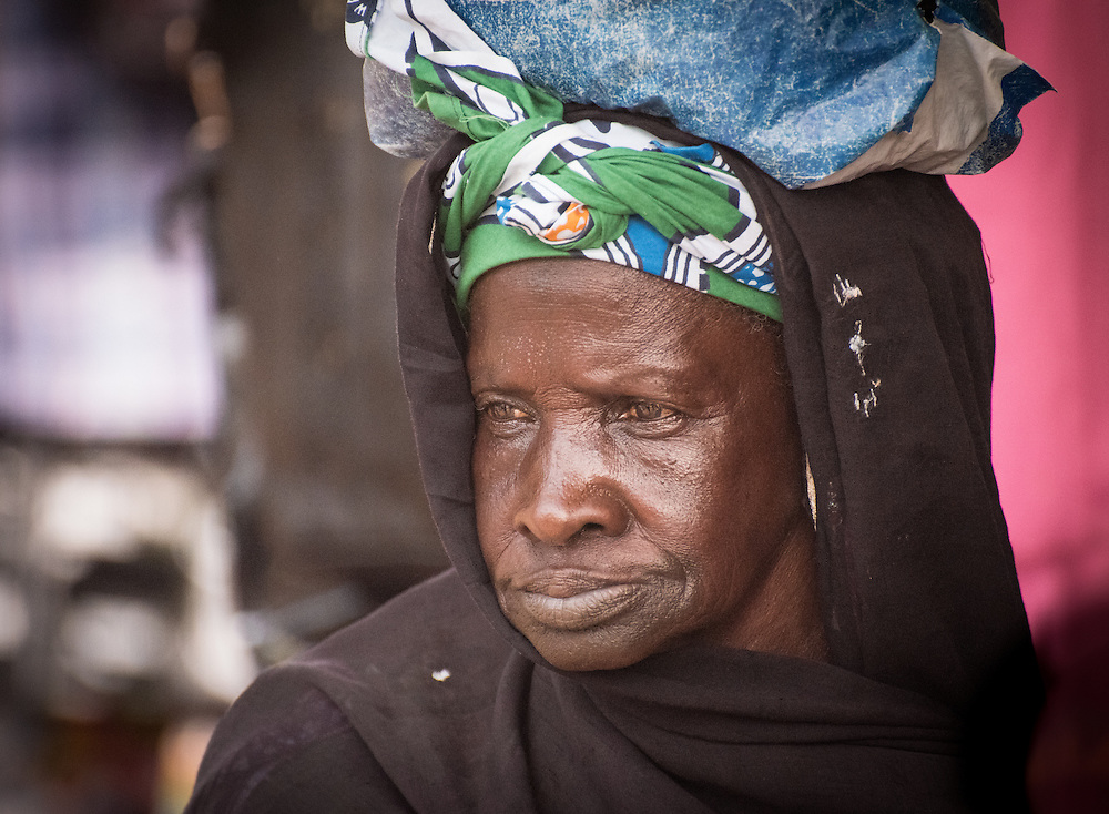 Woman with a bag on her head on a market in Serrekunda, The Gambia.