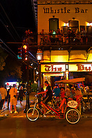 Pedicab passing in front of The Bull & Whistle Bar, Duval Street, Key West, Florida Keys, Florida USA