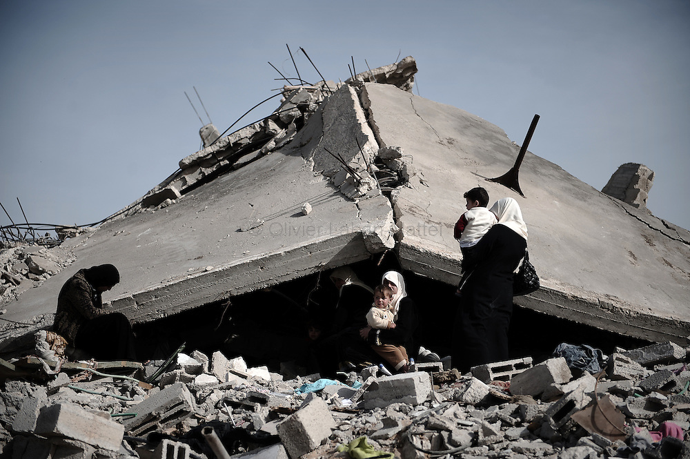 "A Palestinian family sits on the rubble of their destroyed house following Israel's 22-day offensive in Gaza on January 26, 2009 in the northern Gaza Strip district of Jabalia. A senior EU official touring Gaza blasted the ""abominable"" destruction in the enclave and said its ""terrorist"" Hamas rulers bear overwhelming responsibility for the war."