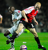 Photo: Leigh Quinnell/Sportsbeat Images.<br /> Milton Keynes Dons v Chesterfield. Coca Cola League 2. 24/11/2007. MK Dons Lloyd Dyer battles with Chesterfields Derek Niven.