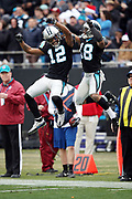 Carolina Panthers wide receiver Kaelin Clay (12) and Carolina Panthers wide receiver Damiere Byrd (18) leap and celebrate with a hip bump after the Panthers score a third quarter touchdown good for a 24-14 Panthers lead during the 2017 NFL week 15 regular season football game against the Green Bay Packers, Sunday, Dec. 17, 2017 in Charlotte, N.C. The Panthers won the game 31-24. (©Paul Anthony Spinelli)