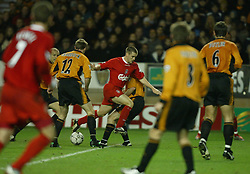 WOLVERHAMPTON, ENGLAND - Wednesday, January 21st, 2004: Liverpool's Michael Owen bursts through the Wolverhampton Wanderers defence during the Premiership match at Molineux. (Pic by David Rawcliffe/Propaganda)