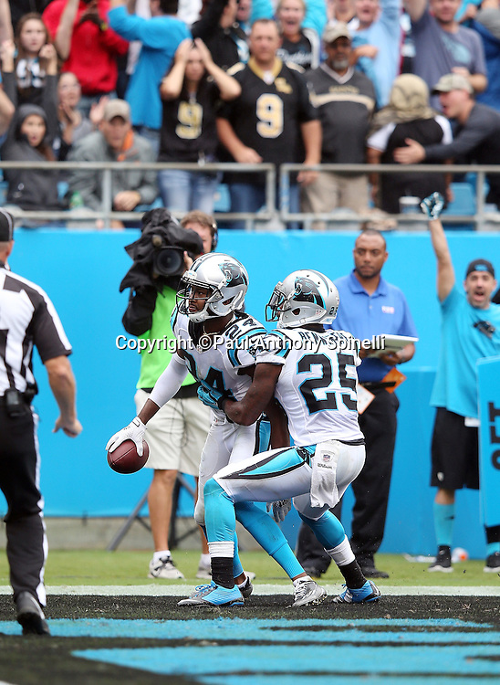 Carolina Panthers cornerback Bene' Benwikere (25) celebrates with Carolina Panthers cornerback Josh Norman (24) after Norman intercepts a fourth quarter Hail Mary pass in the end zone during the 2015 NFL week 3 regular season football game against the New Orleans Saints on Sunday, Sept. 27, 2015 in Charlotte, N.C. The Panthers won the game 27-22. (©Paul Anthony Spinelli)