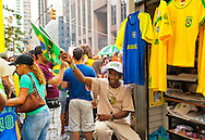 NEW YORK: AUGUST 31:  Street vendor selling Brazilian fFags and shirts at 24th annual Brazilian Day Festival August 31, 2008 on 46th St., in Little Brazil, near Times Square, Manhattan, NYC. Brazilians worldwide came to proudly share their cultural heritage.