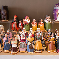 Ceramic figurines on display at Atelier Arterra, a workshop and store located in the Panier neighborhood of Marseille, France, that sells traditional painted ceramic figurines known as santons.