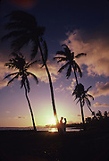 Sunset with couple, Poipu, Kauai, Hawaii<br />
