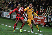 Kallum Mantack of Alfreton Town and Josh Sheehan of Newport County during the The FA Cup match between Newport County and Alfreton Town at Rodney Parade, Newport, Wales on 15 November 2016. Photo by Andrew Lewis.