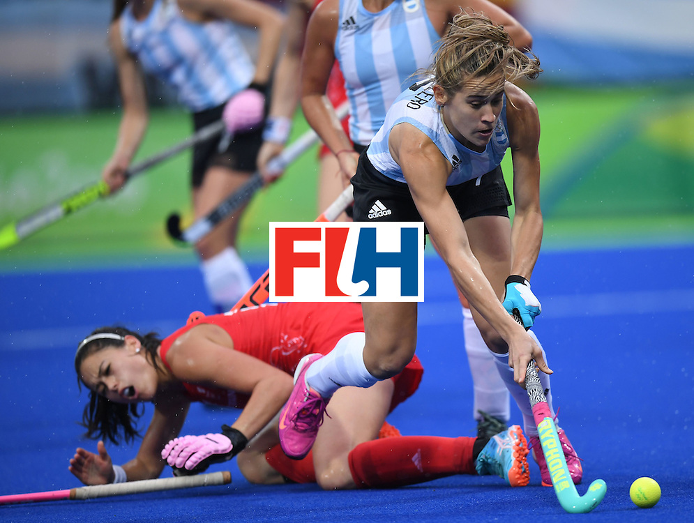 Argentina's Martina Cavallero tries to get past Britain defences during the women's field hockey Britain vs Argentina match of the Rio 2016 Olympics Games at the Olympic Hockey Centre in Rio de Janeiro on August, 10 2016. / AFP / MANAN VATSYAYANA        (Photo credit should read MANAN VATSYAYANA/AFP/Getty Images)