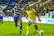 Birmingham City midfielder Jacques Maghoma (19) tussles with Reading defender Andy Yiadom (17) during the EFL Sky Bet Championship match between Reading and Birmingham City at the Madejski Stadium, Reading, England on 7 December 2019.