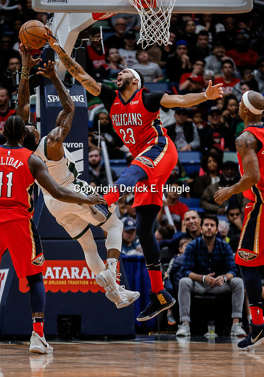 Dec 13, 2017; New Orleans, LA, USA; New Orleans Pelicans forward Anthony Davis (23) blocks a shot by Milwaukee Bucks guard Eric Bledsoe (6) during the second half at the Smoothie King Center. The Pelicans defeated the Bucks 115-108. Mandatory Credit: Derick E. Hingle-USA TODAY Sports