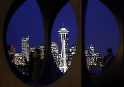 "The Space Needle is seen through the sculpture ""Changing Form"" by Doris Chase during twilight in Seattle. (Erika Schultz / The Seattle Times)"