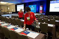 Lou Anne Brossman, founder and President, GMarkU helps set up room for Government Marketing University GAIN 2017 Conference in Reston, VA on Oct. 13, 2017. (Photo by Alan Lessig)