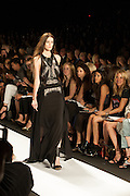 A black dress with lace and leather harness details at the BCBGMAXAZRIA show at the Spring 2013 Mercedes Benz Fashion Week show in New York.