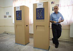 © Licensed to London News Pictures. 30/04/2014. Sulaimaniya, Iraq. An Iraqi-Kurdish male leaves a booth after casting his vote during the 2014 Iraqi parliamentary elections in a school in Sulaimaniya, Iraqi-Kurdistan today (30/04/2014). <br /> <br /> The period leading up to the elections, the fourth held since the 2003 coalition forces invasion, has already seen polling stations in central Iraq hit by suicide bombers causing at least 27 deaths. Photo credit: Matt Cetti-Roberts/LNP