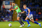 AFC Wimbledon defender Rod McDonald (4) holds off Ipswich Town midfielder Danny Rowe (17) during the EFL Sky Bet League 1 match between Ipswich Town and AFC Wimbledon at Portman Road, Ipswich, England on 20 August 2019.