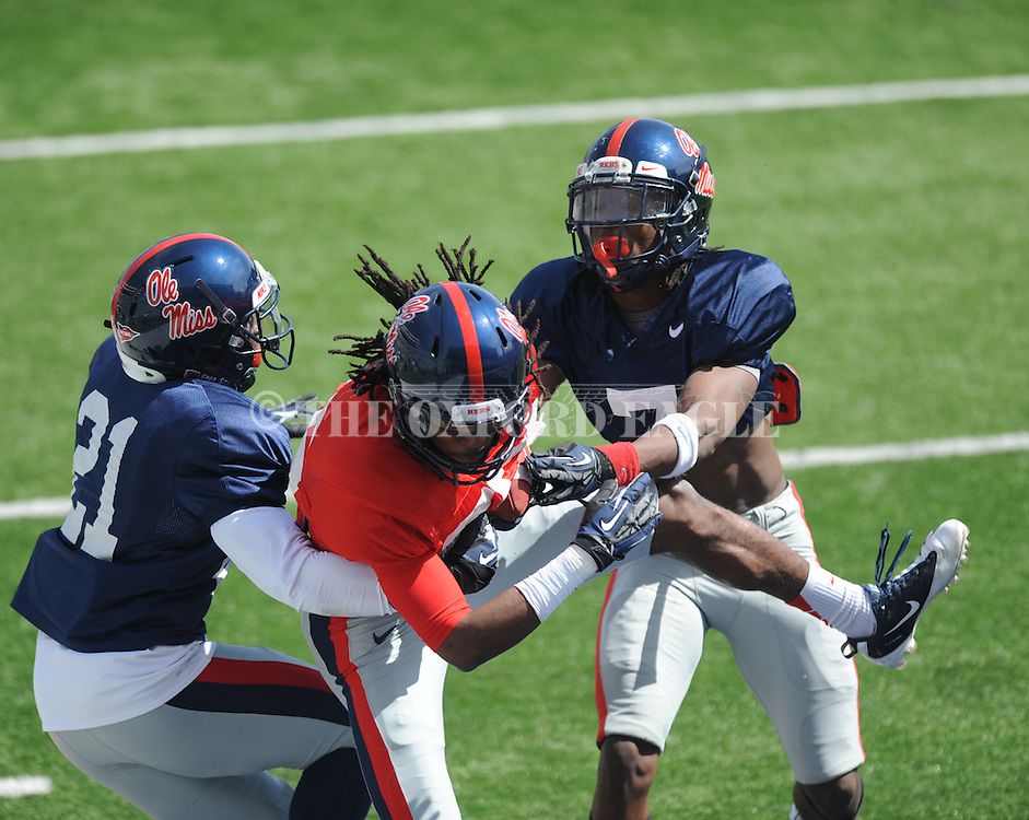 Ja-Mes Logan (85) catches a touchdown pass as Senquez Golson (21) and Trae Elston (7) defend at Ole Miss football scrimmage at Vaught-Hemingway Stadium in Oxford, Miss. on Saturday, April 6, 2013.