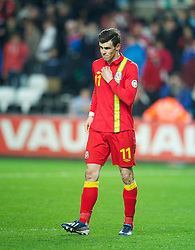 SWANSEA, WALES - Tuesday, March 26, 2013: Wales' Gareth Bale walks off dejected after his side lose 2-1 to Croatia during the 2014 FIFA World Cup Brazil Qualifying Group A match at the Liberty Stadium. (Pic by David Rawcliffe/Propaganda)