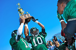 Benjamin L. Johnson Memorial Stadium, Philadelphia PA, USA - November 24 2011; The trophy is presented to the rest of the team by captains Will Parks (11) and Myles Brooker (10).