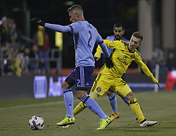 October 31, 2017 - Columbus, OH, USA - Columbus Crew forward Pedro Santos (32) kicks the ball away from New York City FC defender Ben Sweat (2) during the first half of an MLS Eastern Conference Semifinal playoff game against the New York City FC in Columbus, Ohio, on Tuesday, Oct. 31, 2017. (Credit Image: © Adam Cairns/TNS via ZUMA Wire)