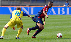 Rigoni pulls Kharja by the shorts during the Serie A match between Chievo and Genova, 20th Sept 2009.