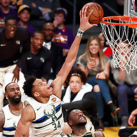 30 March 2018: Milwaukee Bucks forward Giannis Antetokounmpo (34) goes for the dunk during the Milwaukee Bucks 124-122 victory over the LA Lakers, at the Staples Center, Los Angeles, California, USA.
