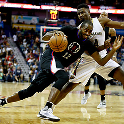 Dec 28, 2016; New Orleans, LA, USA;  Los Angeles Clippers forward Luc Mbah a Moute (12) drives past New Orleans Pelicans forward Solomon Hill (44) during the second quarter of a game at the Smoothie King Center. Mandatory Credit: Derick E. Hingle-USA TODAY Sports
