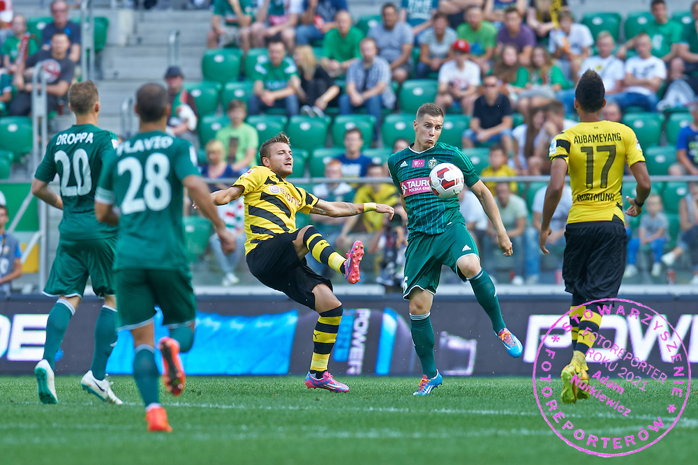 (C) Tomasz Holota of Slask Wroclaw controls the ball during international friendly soccer match between WKS Slask Wroclaw and BVB Borussia Dortmund on Municipal Stadium in Wroclaw, Poland.<br /> <br /> Poland, Wroclaw, August 6, 2014<br /> <br /> Picture also available in RAW (NEF) or TIFF format on special request.<br /> <br /> For editorial use only. Any commercial or promotional use requires permission.<br /> <br /> Mandatory credit:<br /> Photo by &copy; Adam Nurkiewicz / Mediasport