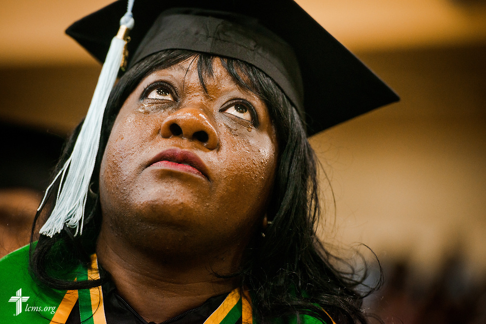 A graduate tears up as she listens to the choir sing at the 92nd and final Commencement Exercises on Saturday, April 28, 2018, in the Julius and Mary Jenkins Center at Concordia College Alabama in Selma, Ala. LCMS Communications/Erik M. Lunsford