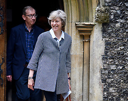 © Licensed to London News Pictures. 24/07/2016. Reading, UK. British Prime Minister THERESA MAY and her husband PHILIP attend church in her constituency in Berkshire, England.. .Photo credit: Ben Cawthra/LNP