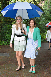 Left to Right, ELIZABETH ACLAND and Katherine Acland at the wedding of Princess Florence von Preussen second daughter of Prince Nicholas von Preussen to the Hon.James Tollemache youngest son of the 5th Lord Tollemache held at the Church of St.Michael & All Angels, East Coker, Somerset on 10th May 2014.