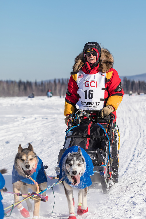 Musher Mitch Seavey competing in the 45rd Iditarod Trail Sled Dog Race on the Chena River after leaving the restart in Fairbanks in Interior Alaska.  Afternoon. Winter.